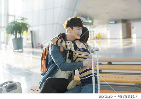 Couple traveling concept, young happy couple at the airport 182 48788117
