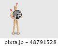 Many red darts missed hit target on dartboard. 48791528