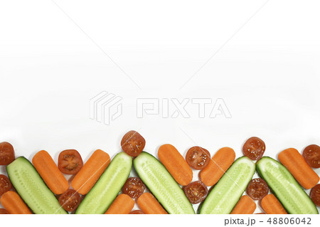 Healthy diet fresh vegetables flat lay border isolated on white. Tomato, carrot, cucumber in 48806042