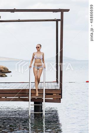 Sensual woman leaving pool 48866699