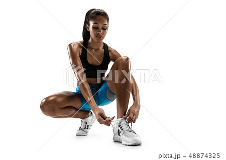 Young african woman running or jogging isolated on white studio background. 48874325