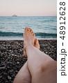 Closeup woman's feet  48912628