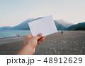 Empty paper note in hand 48912629