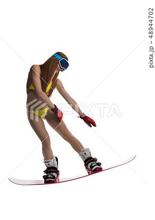 Girl in bikini on snowboard isolated view 48944702