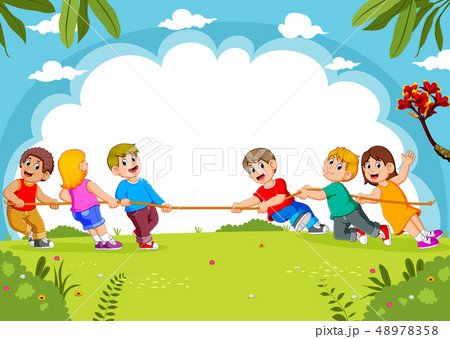 Children play tug of war in the park  48978358