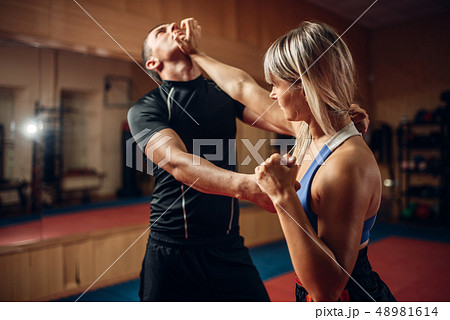Female person on self-defense workout with trainer 48981614
