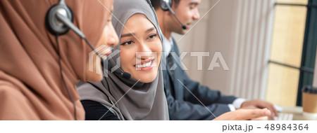 Beautiful Asian muslim woman working  in call 48984364