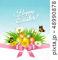 Happy Easter background. Easter eggs in green gras 48990878