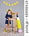 Cute school girl posing in studio shoot in school 48998419
