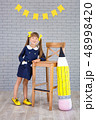 Cute school girl posing in studio shoot in school 48998420