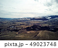 Aerial shot of the mountains covered in snow near 49023748