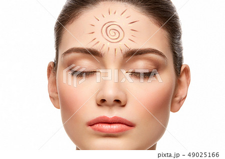 girl with sun drawing on forehead isolated on white 49025166