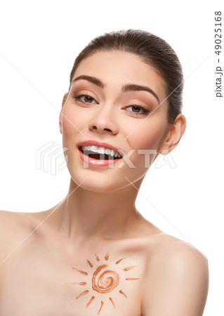 girl with sun drawing on forehead is 49025168