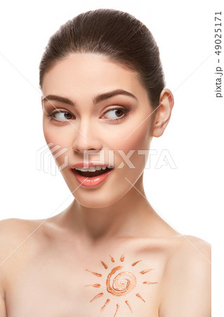 girl with sun drawing on forehead iso 49025171