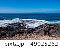 beautiful view on ocean water and black lava sand 49025262