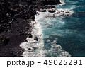 beautiful view on ocean water and black lava sand 49025291