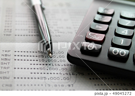 Calculator and pen on savings account passbook  49045272