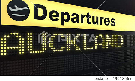 Flight to Auckland on international airport departures board. Travelling to New Zealand conceptual 49058665