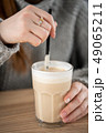 Young women are drinking latte coffee placed on a table at cafe in holiday. 49065211