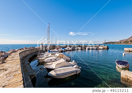 Boats moored in a small harbor in the Gulf of 49115211