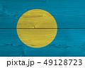 Palau flag painted on old wood plank 49128723