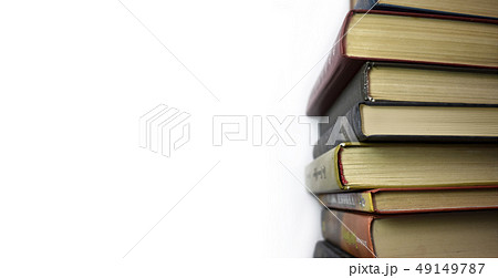 Stack of multicolored books. Old textbooks stacked on each other. Online education training skill 49149787