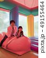遊園地のエアー遊具で遊ぶ親子 49155464