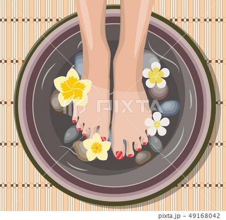 Female feet at spa pedicure procedure. 49168042