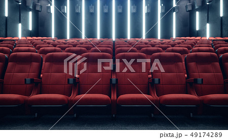 Cinema hall with blank screen and empty seats. Modern design with striking lighting, neon lighting 49174289
