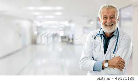 Senior male doctor working at the hospital. 49181139