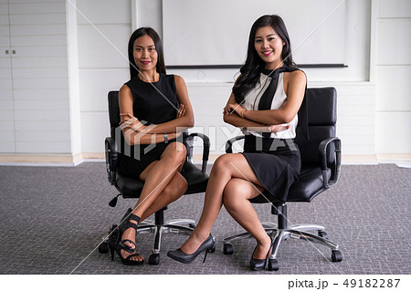 Young Asian businesswomen standing in office. 49182287