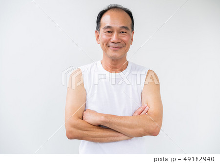 Happy healthy senior grandfather in gym fitness. 49182940