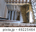 Concrete staircase with wrought iron railings 49225464