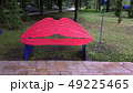 Bench for lips-shaped kisses in a city park. Red 49225465