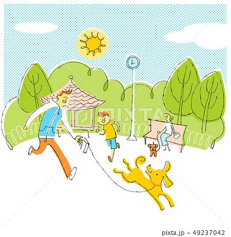 公園で遊ぶイヌと親子 49237042