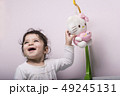 Happy little girl playing and enjoying with her 49245131