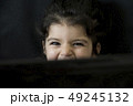 Close up portrait of a little girl behind laptop 49245132