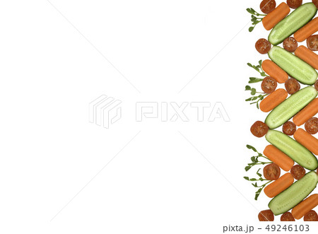 Healthy diet fresh vegetables flat lay border isolated on white. Tomato, carrot, cucumber in 49246103