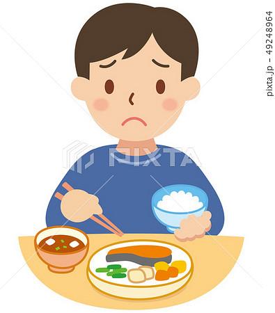 食事をする困り顔の男性 49248964
