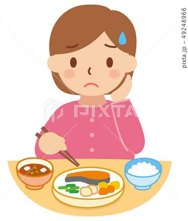食事をする困り顔の女性 49248966