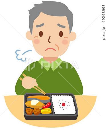 コンビニ弁当を食べる困り顔のおじいちゃん 49248993