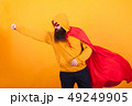 Bearded hipster dressed in superhero costume flying away to save the world ovr yellow background 49249905