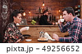 Zoom in shot of beautiful couple drinking coffee in vintage rustic coffee shop pub restaurant 49256652