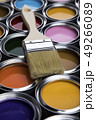 Metal tin cans with color paint and paintbrush 49266089