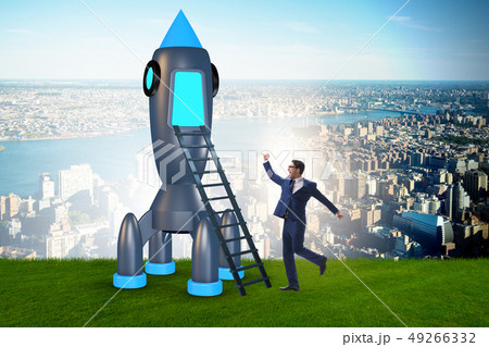 Young businessman boarding space rocket in start-up concept 49266332
