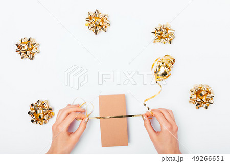 Woman's hands packing gift box 49266651