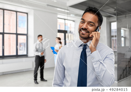 indian businessman calling on smartphone at office 49284015