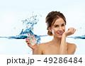 happy woman with perfume over water splash 49286484