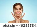 smiling young woman over blue background 49286584