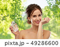 happy woman with perfume over gray background 49286600